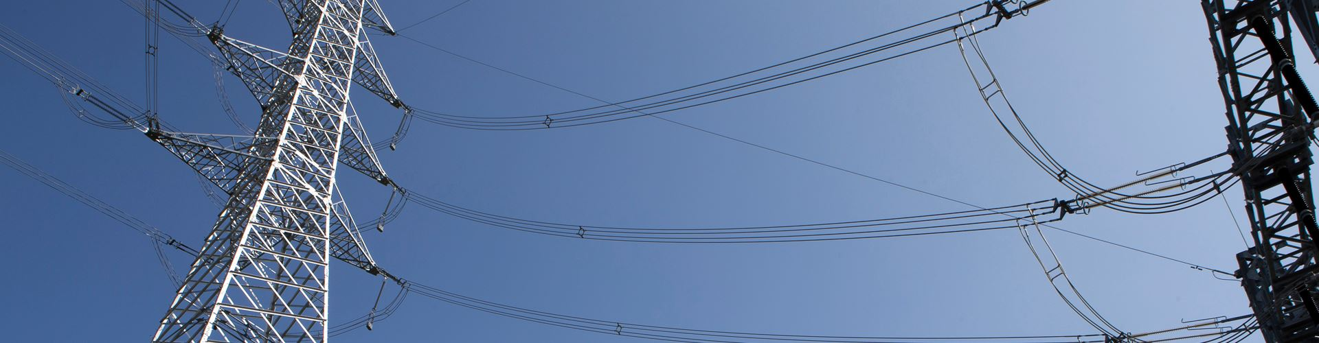 Transmission lines against a blue sky