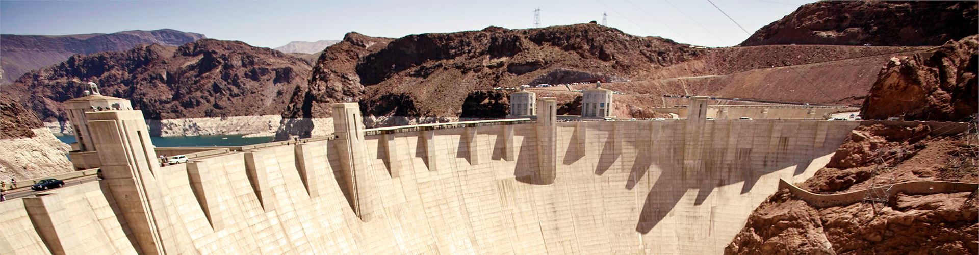 Concrete face of the Hoover Dam in the Nevada hills.