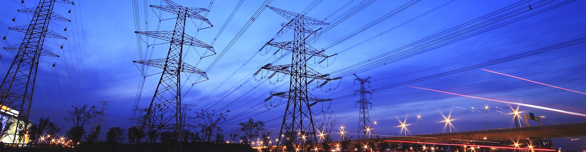 Transmission towers at night