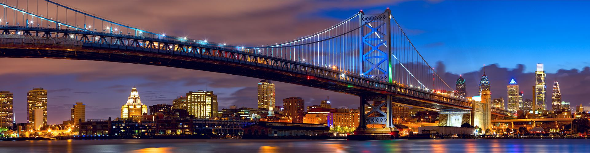 Philadelphia skyline panorama and Ben Franklin Bridge at dusk